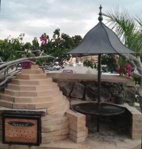 Barbacoa y puerta de horno en hierro forjado